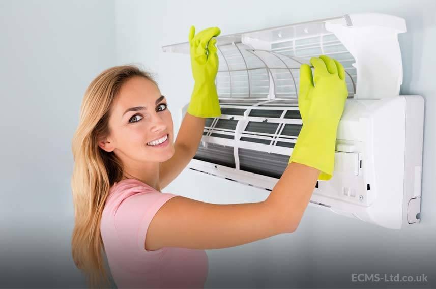 Girl Cleaning HVAC Unit